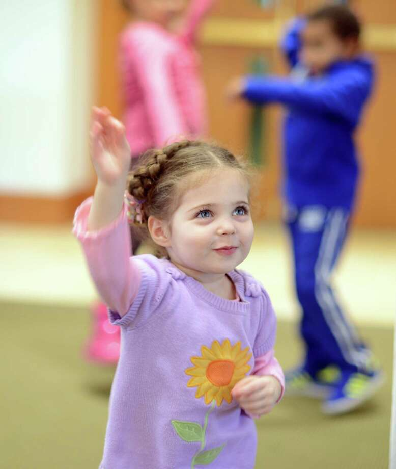 Three-year-old Simone Tsyrulnik, of Shelton, dances during the Young Families Havurah at Congregation B'nai Israel in Bridgeport Saturday, Jan. 18, 2013.  The Shabbat morning community meets every Saturday morning at B'nai Israel for music, arts, fun, and more starting around 9:30 for bagels and then at 9:45 for Shabbat singing and service. All families with children 5 years and younger are welcome to attend. Photo: Autumn Driscoll / Connecticut Post