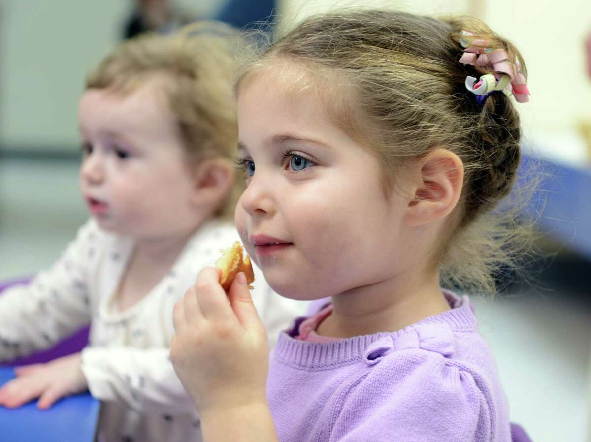Three-year-old Simone Tsyrulnik, of Shelton, enjoys challah and grape juice during the Young Families Havurah at Congregation B'nai Israel in Bridgeport Saturday, Jan. 18, 2013. The Shabbat morning community meets every Saturday morning at B'nai Israel for music, arts, fun, and more starting around 9:30 for bagels and then at 9:45 for Shabbat singing and service. All families with children 5 years and younger are welcome to attend.