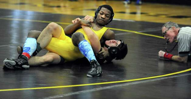 Harding's Xavier Bass, top, and East Haven's Jose Magana compete in the 170lb weight class during a wrestling invitational Saturday, Jan. 18, 2014, at Jonathan Law High School in Milford, Conn. Photo: Autumn Driscoll / Connecticut Post