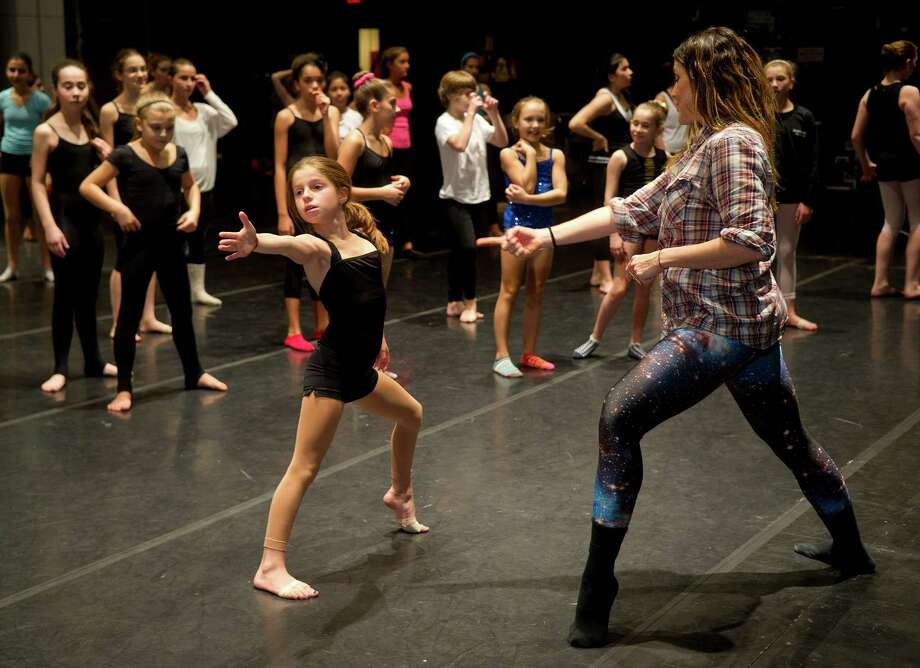 Dancers are taught by Kristin Sudeikis as they participate in the intermediate contemporary dance class during the 12th annual DanceFest at the Palace Theatre in Stamford, Conn., on Saturday, January 18, 2014. Photo: Lindsay Perry / Stamford Advocate