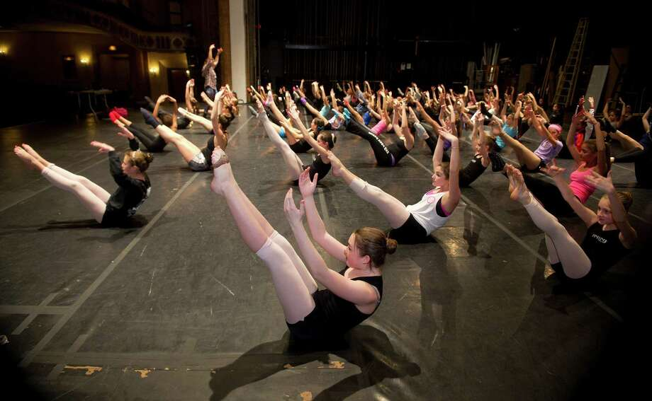 Dancers, including Kirsten McCorry, 14, front center, participate in the intermediate contemporary dance class during the 12th annual DanceFest at the Palace Theatre in Stamford, Conn., on Saturday, January 18, 2014. Photo: Lindsay Perry / Stamford Advocate