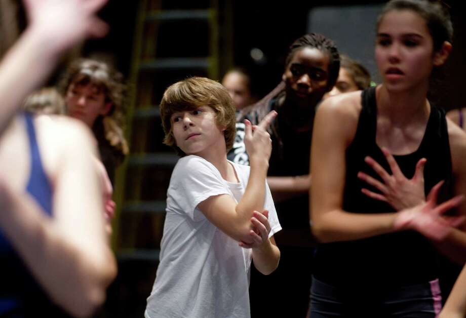 Dancers participate in the intermediate contemporary dance class during the 12th annual DanceFest at the Palace Theatre in Stamford, Conn., on Saturday, January 18, 2014. Photo: Lindsay Perry / Stamford Advocate