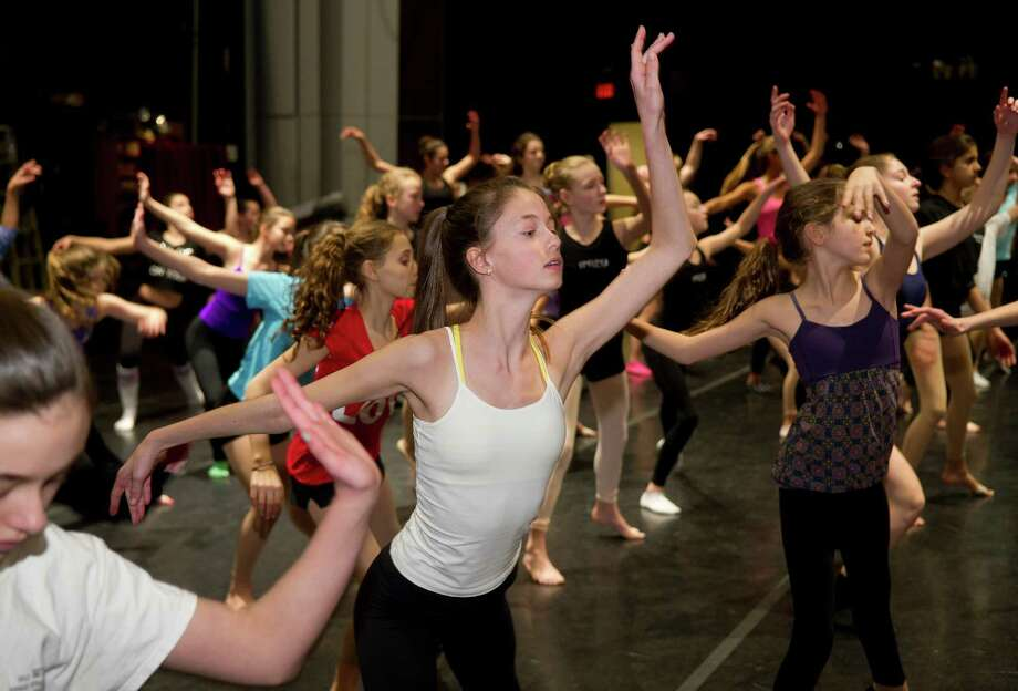 Meredith Antell, 13,  participates in the intermediate contemporary dance class during the 12th annual DanceFest at the Palace Theatre in Stamford, Conn., on Saturday, January 18, 2014. Photo: Lindsay Perry / Stamford Advocate