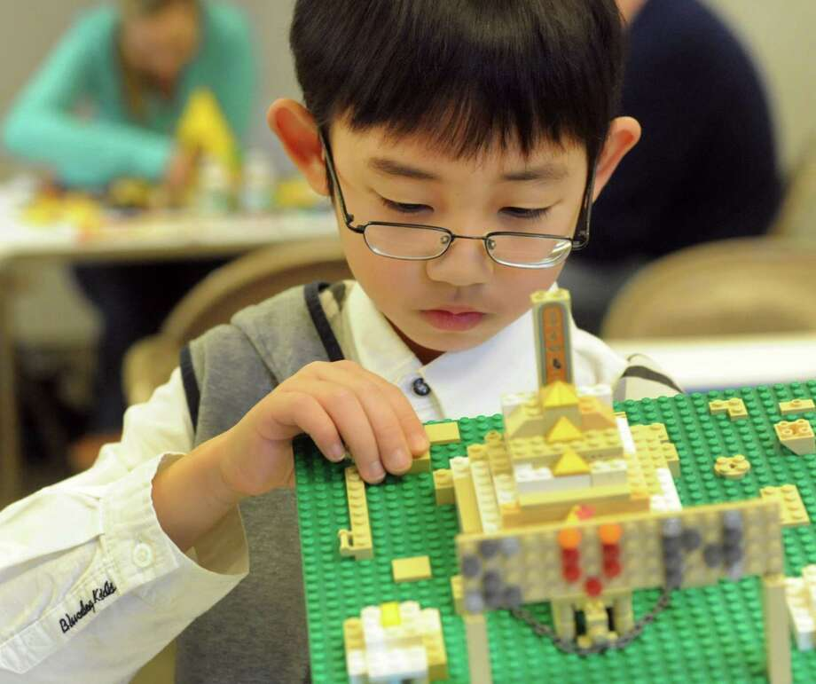 Zeroun Ni, 8, of Albany adds Legos to his pyramid project during the Lego Building Challenge on Saturday, Jan. 18, 2014, at the Albany Institute of History and Art in Albany, N.Y. This year's theme was Egypt: Past, Present, and Future. (Cindy Schultz / Times Union) Photo: Cindy Schultz / 00025420A