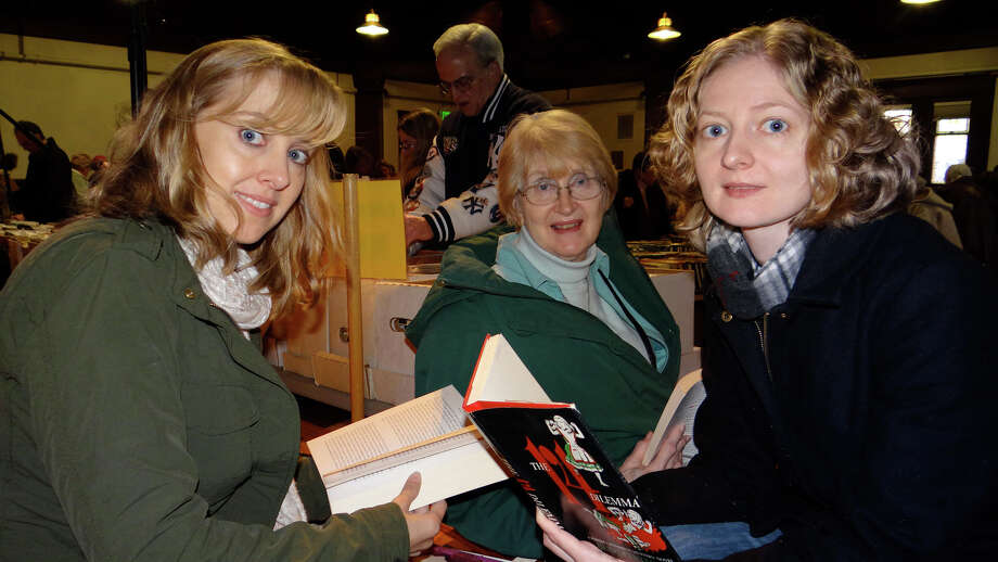 Marianne, Charlotte and Anneliese Minnich traveled from Somers, N.Y., to browse the offerings Saturday at the Pequot Library's Mid-Winter Book Sale. Photo: Mike Lauterborn / Fairfield Citizen contributed