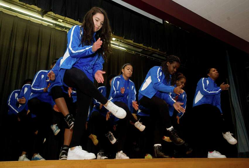 The Cloonan Middle School step team performs during Saturday's MLK Day of Peace event at Trailblazers Academy in Stamford, Conn., on January 18, 2014.