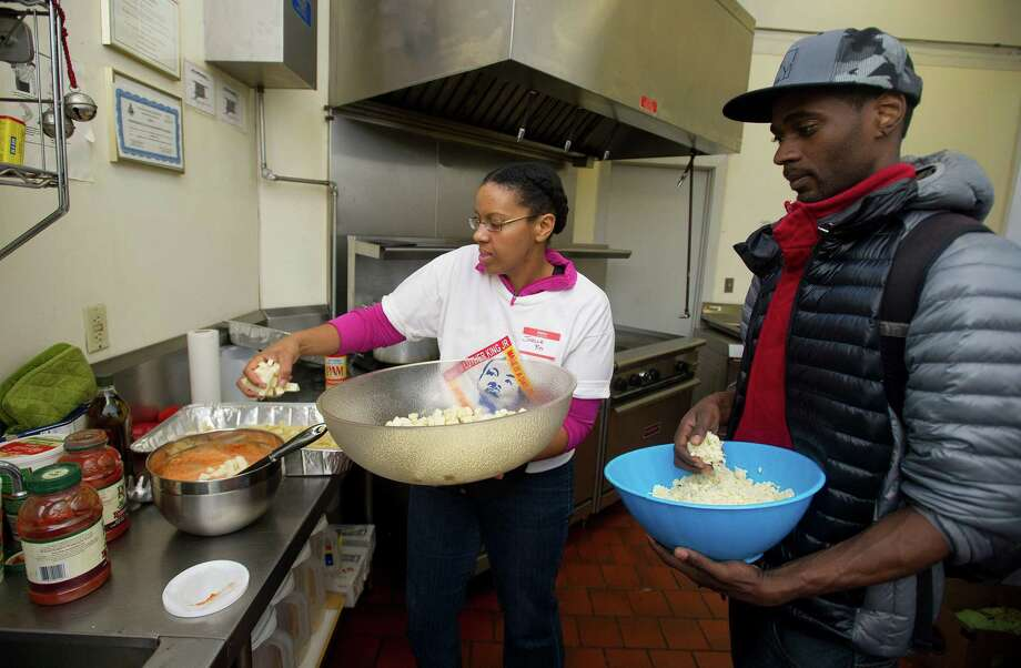 Smokey Sims and Joelle Roy prepare a meal at Inspirica's women's shelter during Saturday's MLK Day of Peace event at Trailblazers Academy in Stamford, Conn., on January 18, 2014. Photo: Lindsay Perry / Stamford Advocate