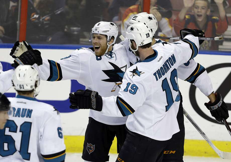 Forward Joe Pavelski (center) celebrates one of his three second-period goals, two of which came in a 21-second span. Photo: Lynne Sladky, Associated Press
