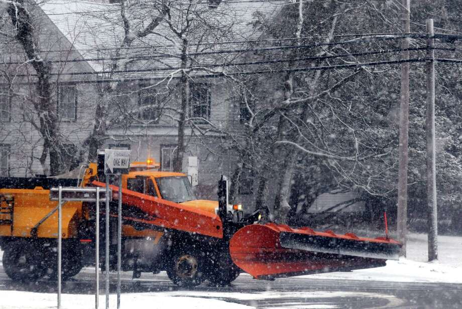 A snow plow makes the rounds during a snow flurry along Kenwood Avenue on Saturday Jan. 18, 2014 in Delmar, N.Y.  (Michael P. Farrell/Times Union) Photo: Michael P. Farrell / 00025422A