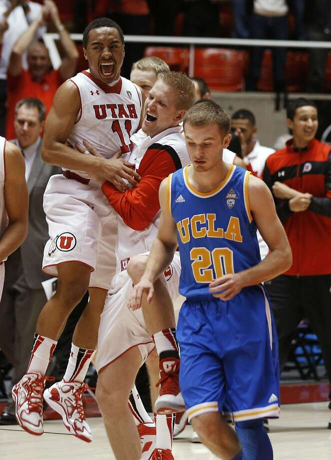Utah's Brandon Taylor (11) and Jeremy Olsen celebrate as UCLA's Bryce Alford leaves the court. Photo: George Frey, Associated Press