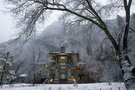 (NYT23) YOSMITE VALLEY, Calif. -- Dec. 20, 2007 -- HOLIDAY-LODGES -- The Ahwahnee Hotel in Yosemite National Park in Yosemite Valley Calif., Dec. 18, 2007. For the peace-loving merrymakers who choose to spend the holidays in the remote beauty of AmericaÕs most beloved national parks, appropriate accommodations await. The timbered interiors and giant stone fireplaces of the grand national park lodges, some a century old, seem made for the seasonal trimmings of evergreen boughs and pine cone wreaths. And inside their comfortable guest rooms and well-provisioned dining halls, nobody's roughing it. (Peter DaSilva/The New York Times)