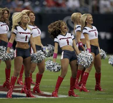 HOUSTON - OCTOBER 04:  Houston Texans cheerleaders perform during a game between the Houston Texans and Oakland Raiders at Reliant Stadium on October 4, 2009 in Houston, Texas.  (Photo by Bob Levey/Getty Images) Photo: Bob Levey, Getty Images / 2009 Getty Images