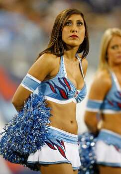 NASHVILLE, TN - OCTOBER 11:  A Tennessee Titans cheerleader looks on during the NFL game against the Indianapolis Colts at LP Field on October 11, 2009 in Nashville, Tennessee. The Colts defeated the Titans 31-9.  (Photo by Andy Lyons/Getty Images) Photo: Andy Lyons, Getty Images / 2009 Getty Images