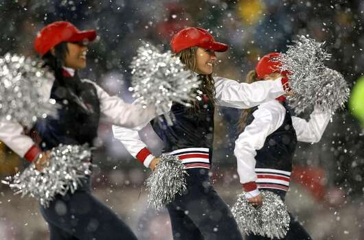 FOXBORO - OCTOBER 18:  Cheerleaders of the New England Patriots dance on the field during a game against the Tennessee Titans at Gillette Stadium on October 18, 2009 in Foxboro, Massachusetts. The Patriots won 59-0. (Photo by Jim Rogash/Getty Images) Photo: Jim Rogash, Getty Images / 2009 Getty Images