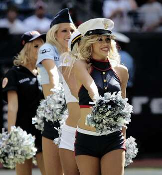 HOUSTON - OCTOBER 25:  The Houston Texans cheerleaders perform dressed in different uniforms of the military at Reliant Stadium on October 25, 2009 in Houston, Texas.  (Photo by Bob Levey/Getty Images) Photo: Bob Levey, Getty Images / 2009 Getty Images