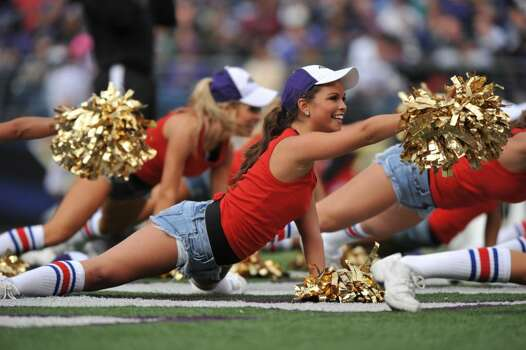 BALTIMORE - NOVEMBER 1:  Cheerleaders for the Baltimore Ravens cheer against the Denver Broncos at M&T Bank Stadium on November 1, 2009 in Baltimore, Maryland. The Ravens defeated the Broncos 30-7. (Photo by Larry French/Getty Images) Photo: Larry French, Getty Images / 2009 Larry French