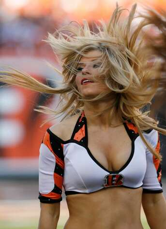 CINCINNATI - NOVEMBER 8: Cincinnati Bengals cheerleaders cheer for their team against Baltimore Ravens at Paul Brown Stadium on November 8, 2009 in Cincinnati, Ohio.  (Photo by John Sommers II/Getty Images) Photo: John Sommers II, Getty Images / 2009 Getty Images