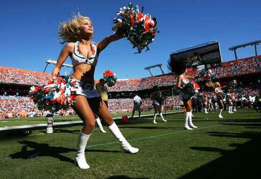 MIAMI GARDENS, FL - NOVEMBER 15:  A Dolphin cheerleader performs as the Tampa Bay Buccaneers take on the Miami Dolphins at Land Shark Stadium on November 15, 2009 in Miami Gardens, Florida. The Dolphins defeated the Buccaneers 25-23.  (Photo by Doug Benc/Getty Images) Photo: Doug Benc, Getty Images / 2009 Getty Images