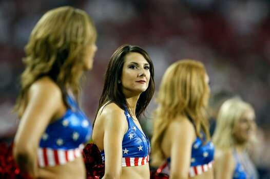 GLENDALE, AZ - NOVEMBER 15:  An Arizona Cardinals cheerleader performs during the game against the Seattle Seahawks at University of Phoenix Stadium on November 15, 2009 in Glendale, Arizona. The Cardinals defeated the Seahawks 31-20.  (Photo by Jeff Gross/Getty Images) Photo: Jeff Gross, Getty Images / 2009 Getty Images
