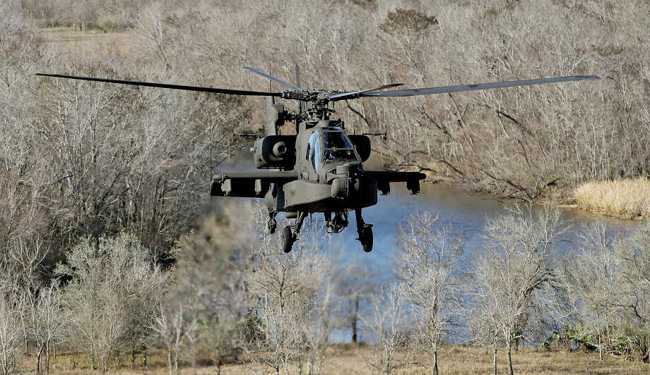 An AH-64D Apache Longbow flies over the Wallisville Tactical Training Area near Houston, Tx. Photo: Edward A. Ornelas, San Antonio Express-News / © 2014 San Antonio Express-News
