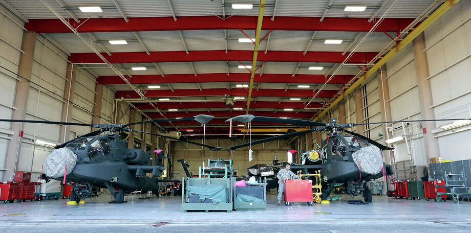 Texas Army National Guard Sgt. Luis Herrera, 25, works on an AH-64D Apache Longbow in the hanger at Ellington Field Joint Reserve Base in Houston, Tx. Photo: Edward A. Ornelas, San Antonio Express-News / © 2014 San Antonio Express-News
