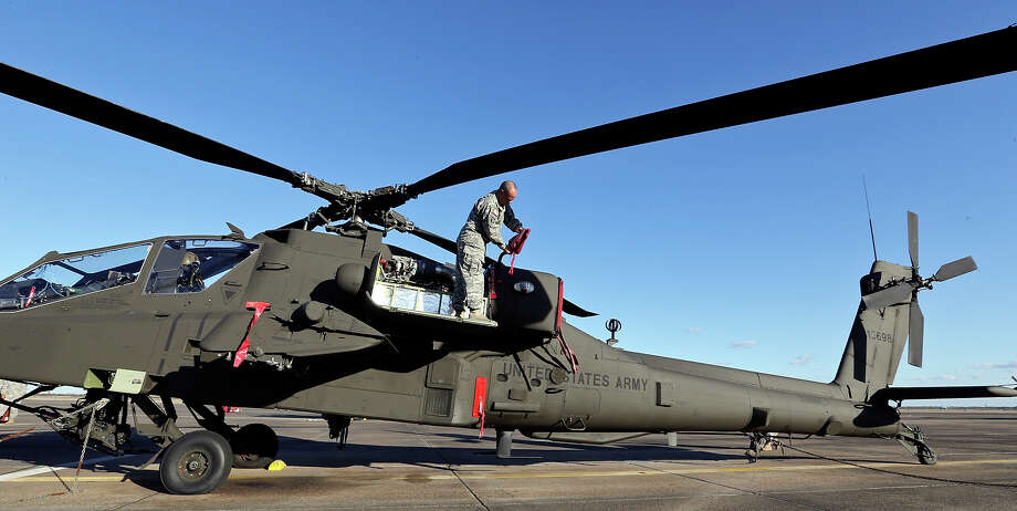 Texas Army National Guard Sgt. Colby Milam, 43, secures an AH-64D Apache Longbow at Ellington Field Joint Reserve Base in Houston, Tx. Photo: Edward A. Ornelas, San Antonio Express-News / © 2014 San Antonio Express-News