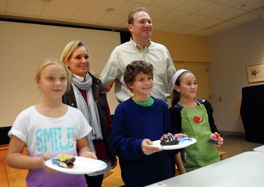 Winners pose with judges Michelle and Frank Weber, who own and operate Cocoa Michelle and CM Market, after they took part in Westport READS: Teen Master Chef competition in the McManus Room at the Westport Library in Westport, Conn. on Saturday January 18, 2014. Winners from left to right are Jessica Schweizer, 10, of Norwalk, Benjamin Cohen, 12, of Westport, and Ella Franzese, 11, of Westport. The kids got to create their own desert and compete for best cupcake, best use of ingrediants, and best presentation. The event ties in with the Westport READ program's highlighting the life and work of master chef Julia Child. Photo: Christian Abraham / Connecticut Post