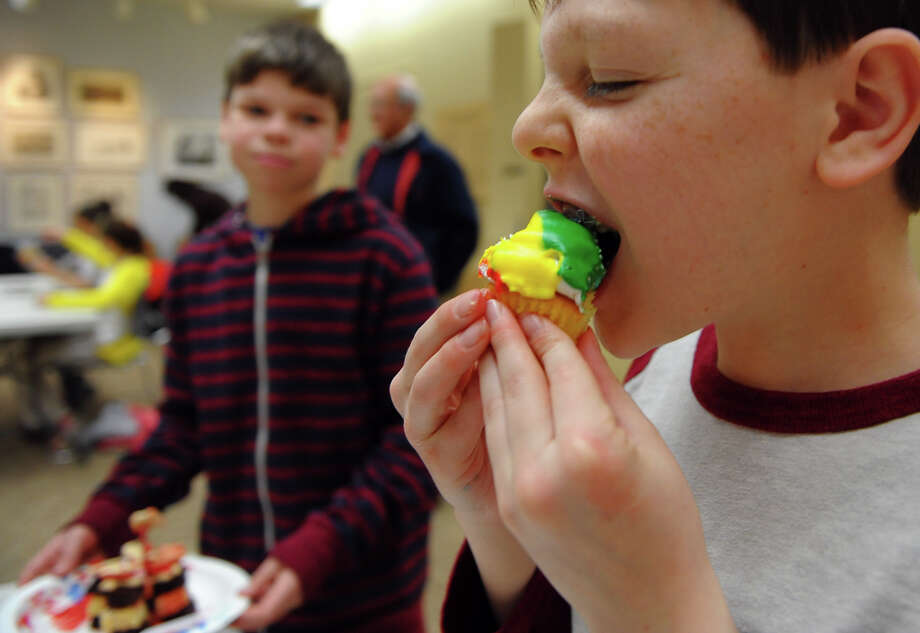 Jake Watzman, 13, of Westport, eats his desert creation after taking part in Westport READS: Teen Master Chef competition in the McManus Room at the Westport Library in Westport, Conn. on Saturday January 18, 2014.  The kids got to create their own desert and compete for best cupcake, best use of ingrediants, and best presentation. The event ties in with the Westport READ program's highlighting the life and work of master chef Julia Child. Photo: Christian Abraham / Connecticut Post