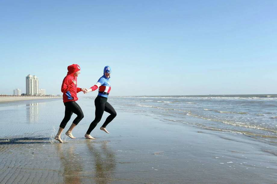 Plungers dressed as super heroes Captain America and Spiderman enter the water during the 2014 Polar Plunge, Saturday, January 18, 2014 on Stewart Beach in Galveston, Texas. The annual event, hosted by the Special Olympics, raises money for Gulf Coast special athletes. Photo: Todd Spoth, For The Chronicle / © TODD SPOTH, 2014