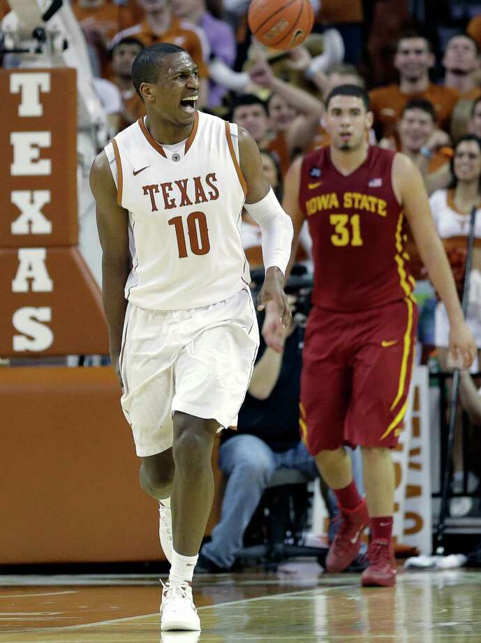 Texas' Jonathan Holmes (10) runs up court after he scored against Iowa State during the second half on an NCAA college basketball game, Saturday,  Jan. 18, 2014, in Austin, Texas. Texas won 86-76. (AP Photo/Eric Gay) Photo: Eric Gay, Associated Press / AP