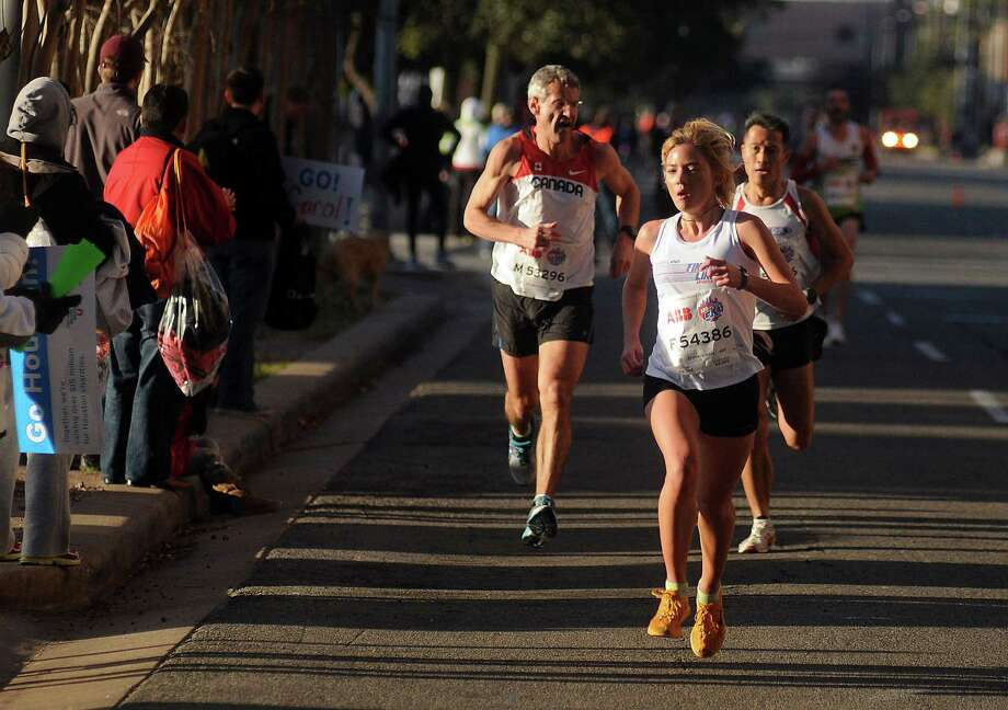 Ladies winner Lauren Smith heads toward the home stretch at the ABB 5K race downtown Saturday Jan 18, 2014. Smith finished with a time of 18.08. Photo: Dave Rossman, For The Houston Chronicle / © 2013 Dave Rossman