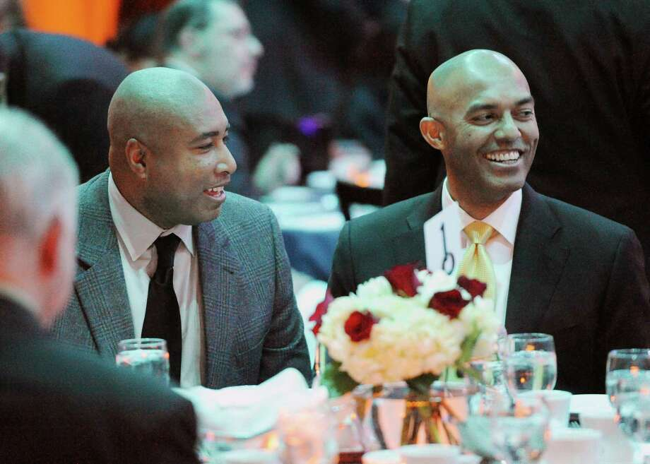 Former New York Yankees Bernie Williams, left, and Mariano Rivera laugh during dinner at the Speak Out Against Hunger benefit for the Hillside Food Outreach at the Matrix Conference & Banquet Center in Danbury, Conn. Saturday, Jan. 18, 2014.  The event was hosted by former Yankee player and Grammy-nominated jazz musician Bernie Williams with special guest Mariano Rivera. Photo: Tyler Sizemore / The News-Times