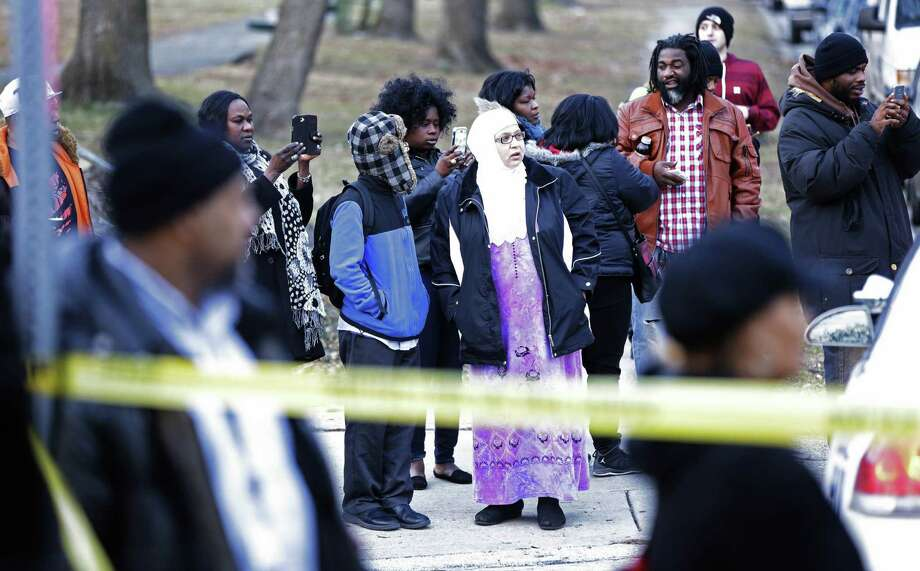 Some of the people outside Delaware Valley Charter School were taking pictures of it as they waited for news after the shooting on Friday. Photo: Matt Rourke / Associated Press / AP