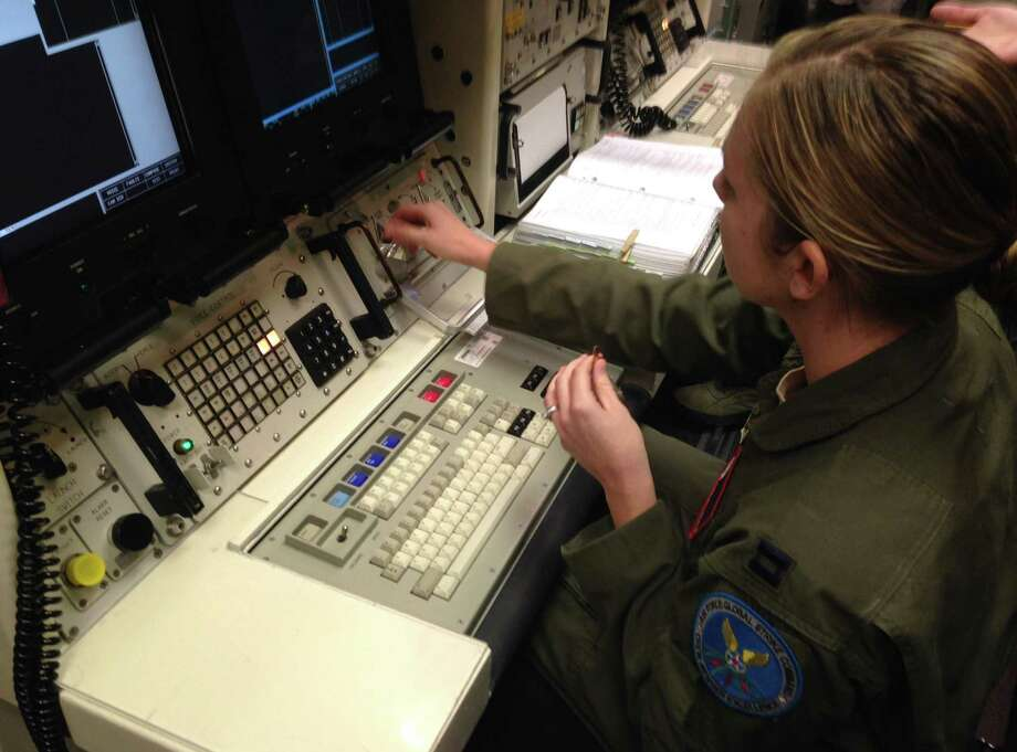 Capt. Lauren Choate, a Minuteman 3 missile launch officer, mans the console of a launch simulator used for training at Warren AFB in Wyoming this month. Launch control officers at this base and others have been retested. Photo: Robert Burns / Associated Press / AP