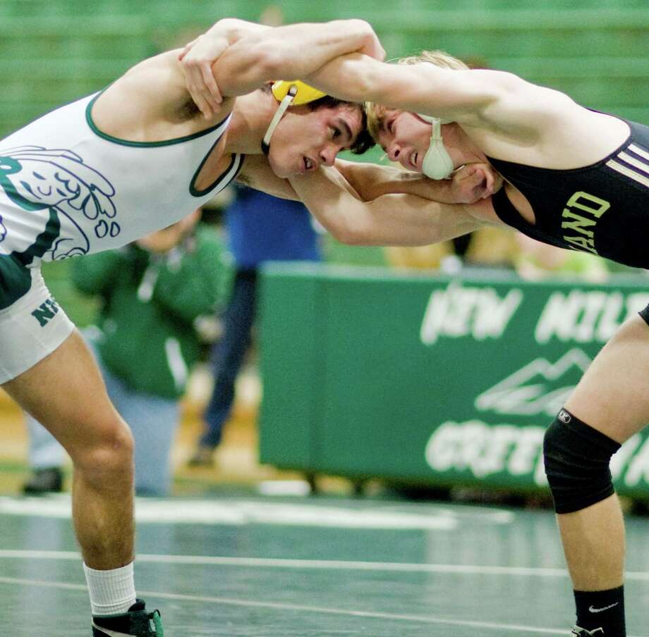 Niko Stefanatos of New Milford High School squares off with Liam Sullivan of Daniel Hand High School in the 126 lb. class during the 32nd annual New Milford High School Wrestling Tournament. Saturday, Jan. 18, 2014 Photo: Scott Mullin / The News-Times Freelance