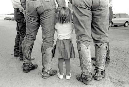 CAPTION: LITTLE GIRL WITH COWBOY BOOTS, MULLIN, TEXAS, 1995