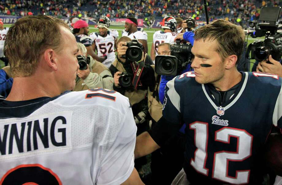 FILE - In this Oct. 7, 2012, file photo, Denver Broncos quarterback Peyton Manning, left, and New England Patriots quarterback Tom Brady, right, speak in the middle of the field after the Patriots beat the Broncos 31-21 in an NFL football game in Foxborough, Mass. Manning and Brady will square off for the 14th time Sunday, Nov. 24, 2013, when the Broncos travel to New England. (AP Photo/Steven Senne, File) ORG XMIT: NY185 ORG XMIT: MER2014011719131359 Photo: Steven Senne / AP