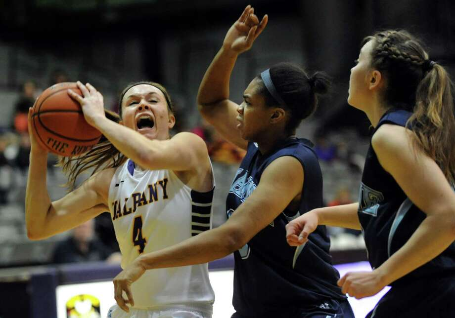 UAlbany's Sarah Royals, left, looks to the hoop as Maine's Chantel Charles, center, and Sigi Koizar defend during their basketball game on Saturday, Jan. 18, 2014, at SEFCU Arena in Albany, N.Y. (Cindy Schultz / Times Union) Photo: Cindy Schultz / 00025424A