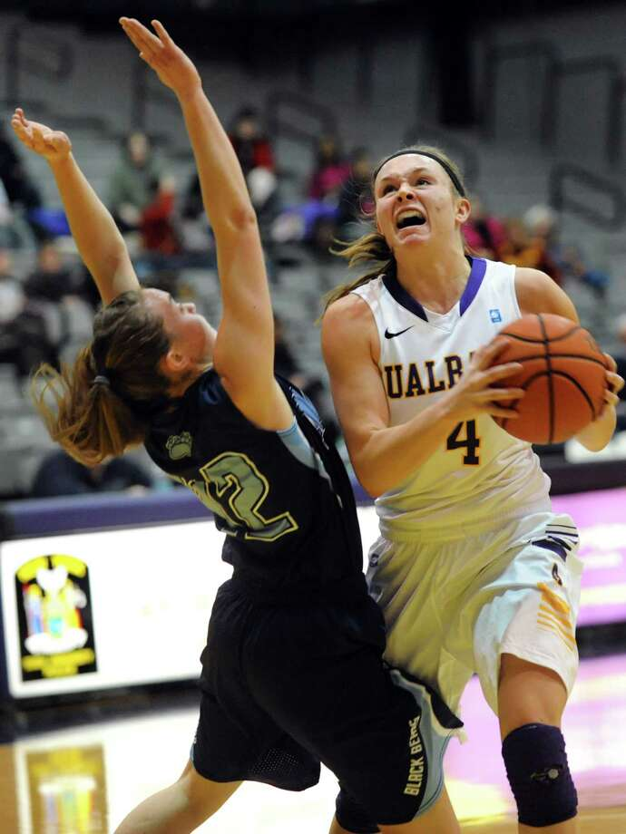 UAlbany's Sarah Royals, right, goes to the hoop as Maine's Sigi Koizar defends during their basketball game on Saturday, Jan. 18, 2014, at SEFCU Arena in Albany, N.Y. (Cindy Schultz / Times Union) Photo: Cindy Schultz / 00025424A