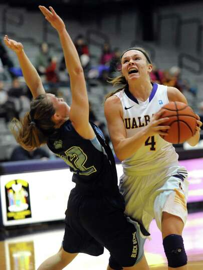 UAlbany's Sarah Royals, right, goes to the hoop as Maine's Sigi Koizar defends during their basketba
