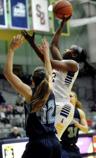 UAlbany's Imani Tate, right, goes to the hoop as Maine's Sigi Koizar defends during their basketball
