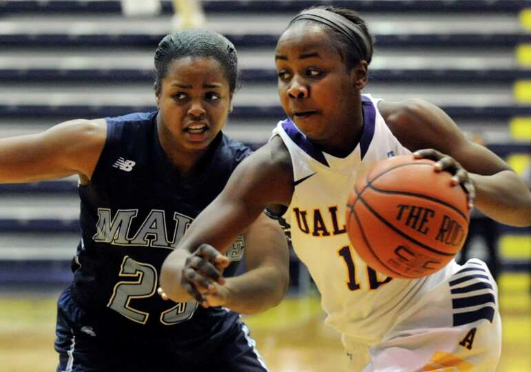 UAlbany's Imani Tate, right, drives the ball as Maine's Ashleigh Roberts defends during their basket