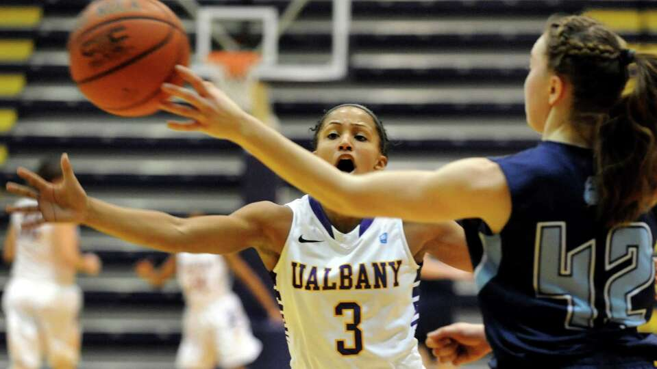 UAlbany's Margarita Rosario, center, defends against Maine's Sigi Koizar during their basketball gam
