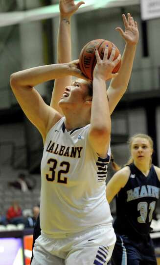 UAlbany's Megan Craig, center, shoots for the hoop during their basketball game against Maine on Sat