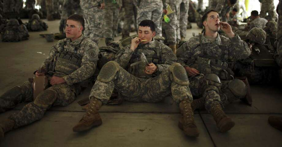 Paratroopers await orders during a deployment exercise at Fort Bragg, N.C., last year. Most troops who fought in wars are home now, readjusting. Photo: Travis Dove / New York Times / NYTNS