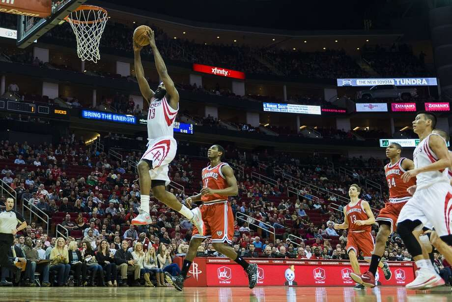 Rockets guard James Harden  goes up for a dunk during the first half. Photo: Smiley N. Pool, Houston Chronicle