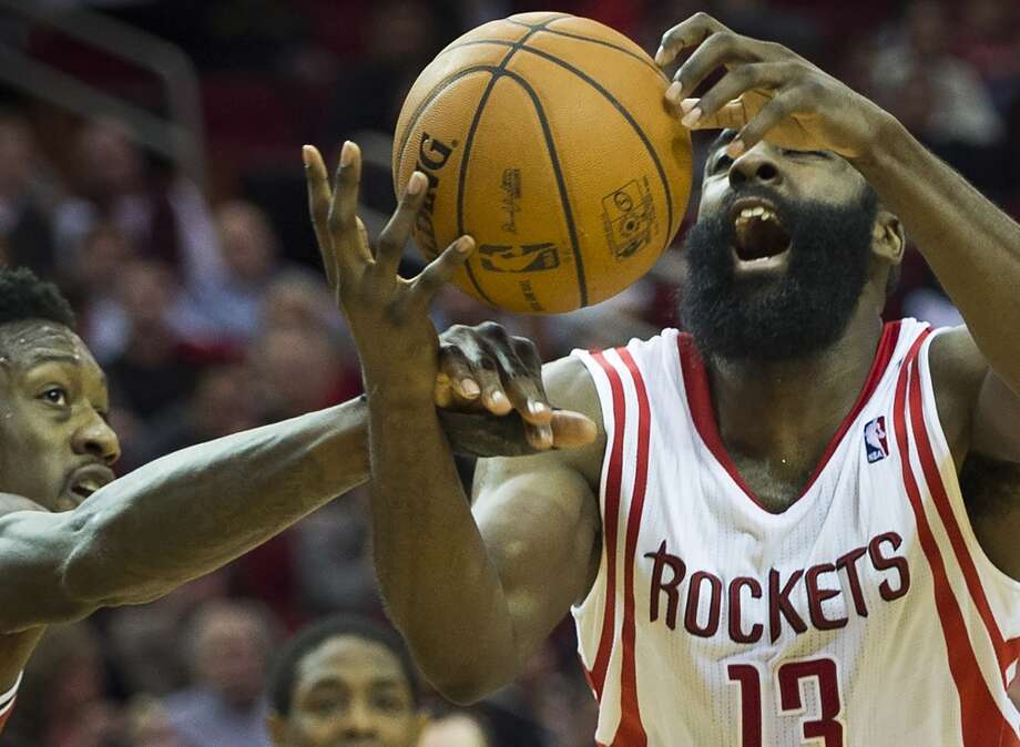 Rockets shooting guard James Harden is fouled by Bucks center Larry Sanders. Photo: Smiley N. Pool, Houston Chronicle