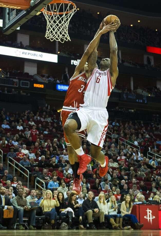 Rockets power forward Terrence Jones is fouled by Bucks guard Giannis Antetokounmpo. Photo: Smiley N. Pool, Houston Chronicle