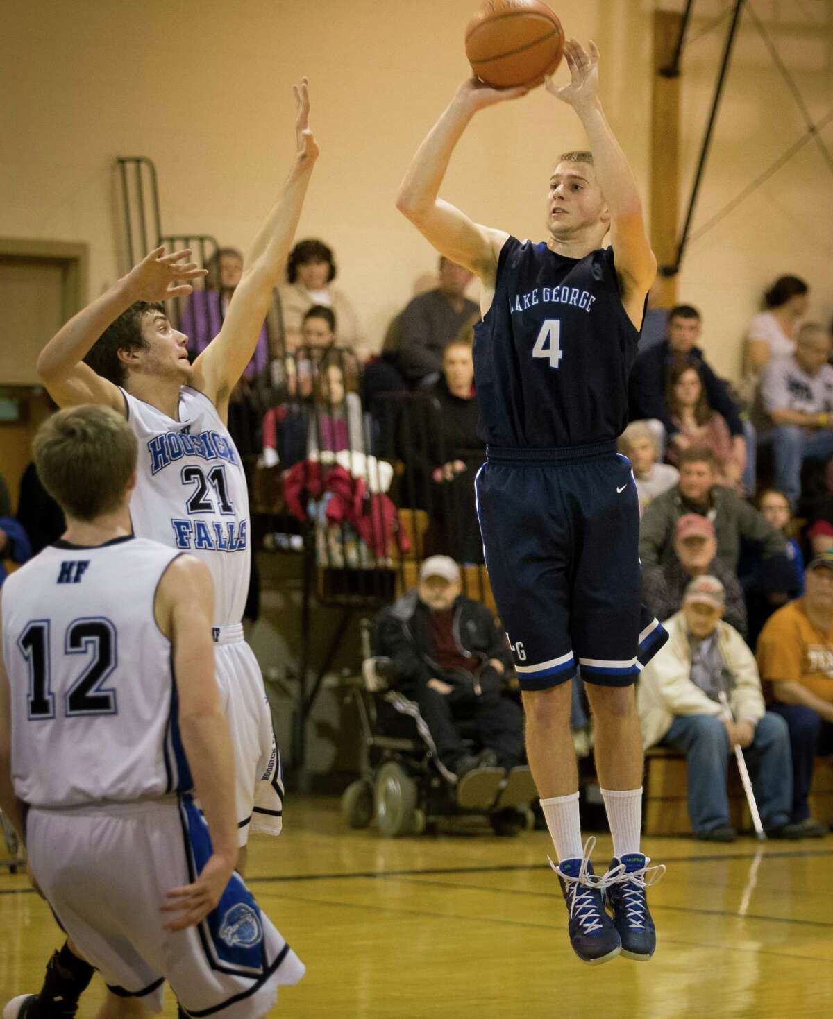 Lake George's #4 Joel Wincowski takes a jump shot over Hoosick Fall's #21 Levi Brewster during the boys' basketball game at Hoosick Falls High School, Saturday, Jan. 18, 2013 in Hoosick Falls, N.Y. (Dan Little / Special to the Times Union)