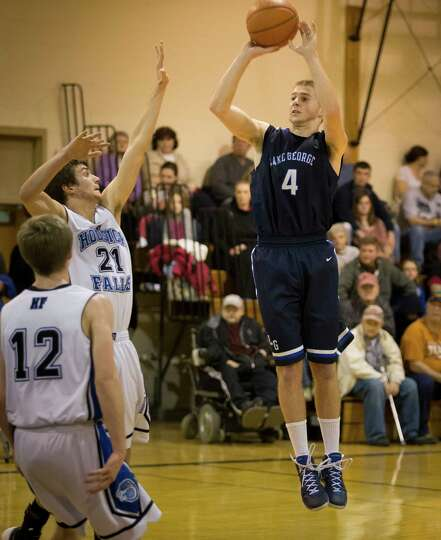 Lake George's #4 Joel Wincowski takes a jump shot over Hoosick Falls' #21 Levi Brewster during the b